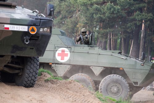 Wroclaw, Poland - May 10. 2014:  AMV XC-360P Rosomak armored vehicle with armored medical support on Military show on May 10, 2014 in Worclaw, Poland
